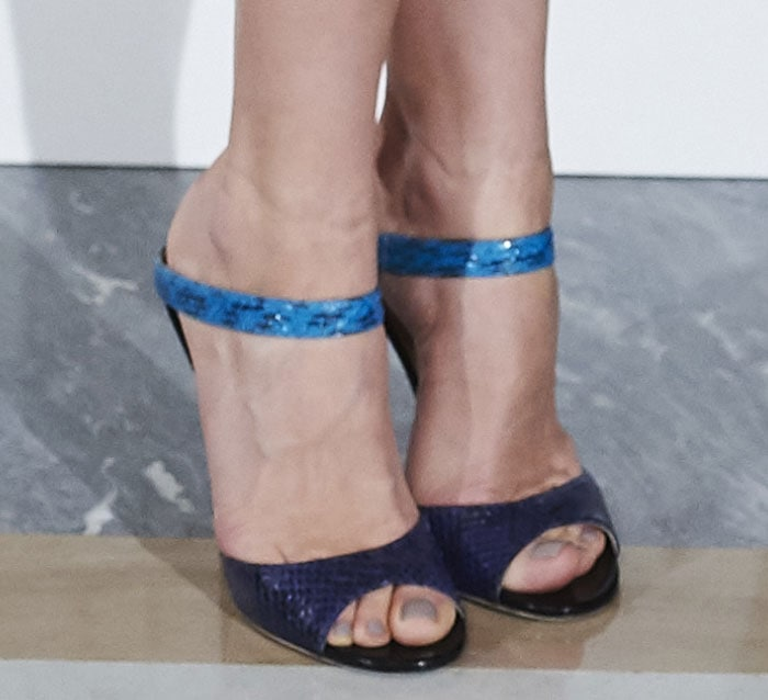 "Olga Kurylenko wearing ""Deckle"" slide sandals by Jimmy Choo"