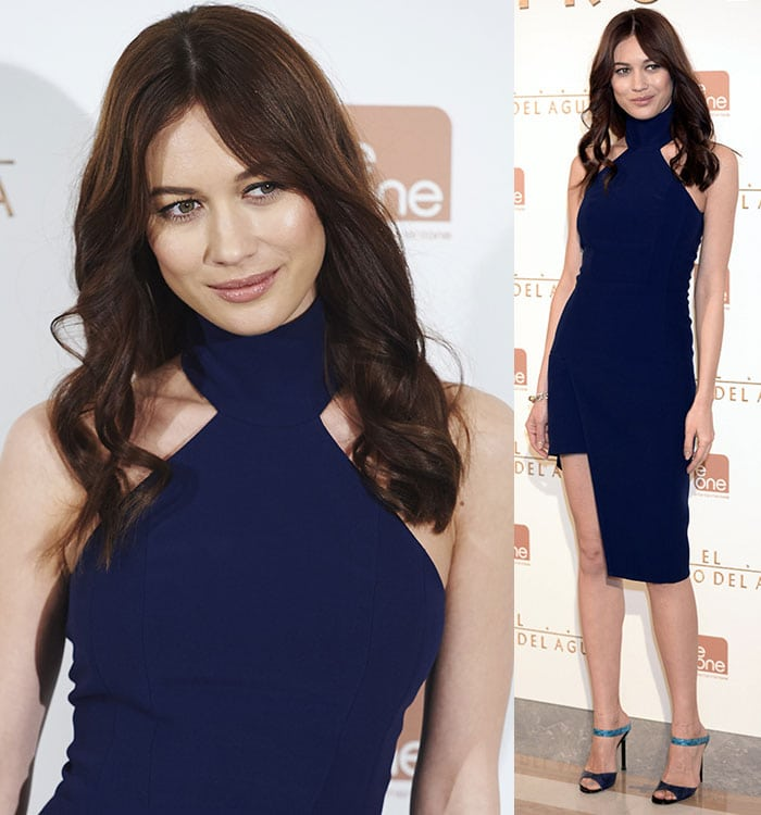 Olga Kurylenko let her hair down in waves, framing her minimally made-up but gorgeous face