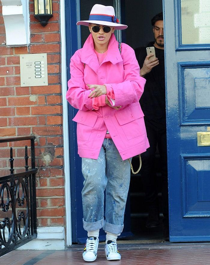 Rita Ora rocked baggy paint-splattered cuffed jeans