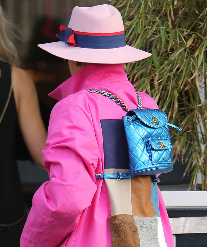 Rita Ora's trilby hat and metallic blue Chanel mini backpack