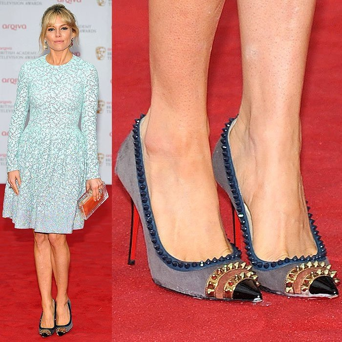 32556568bbb8 Sienna Miller stepping onto a rain-soaked red carpet and consequently  ruining her Christian Louboutin