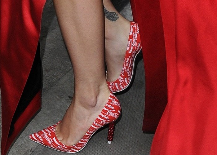 Rita Ora showed off her feet in red Coca Cola pumps