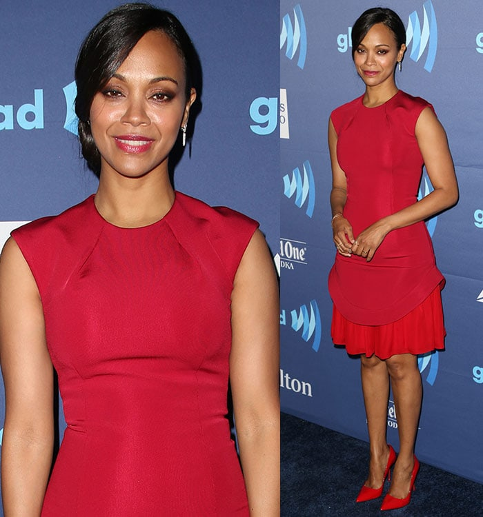 Zoe Saldana tied her hair up in a bun and wore red lipstick