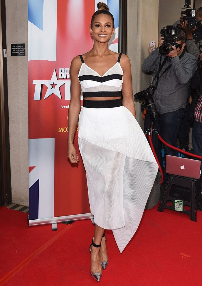 Alesha Dixon flashed her toned midriff in a mesh bralette and a midi skirt
