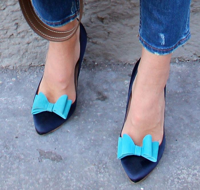 Blanka in blue pumps with lovely bow details at the pointed toes