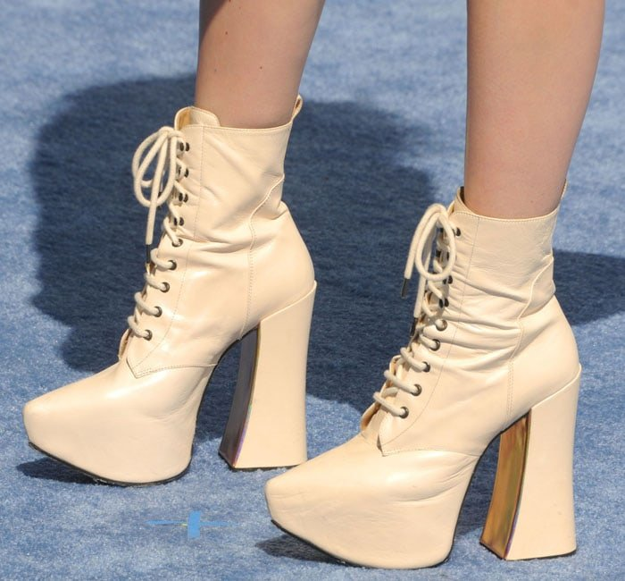 Charli XCX wearing sky high stripper booties