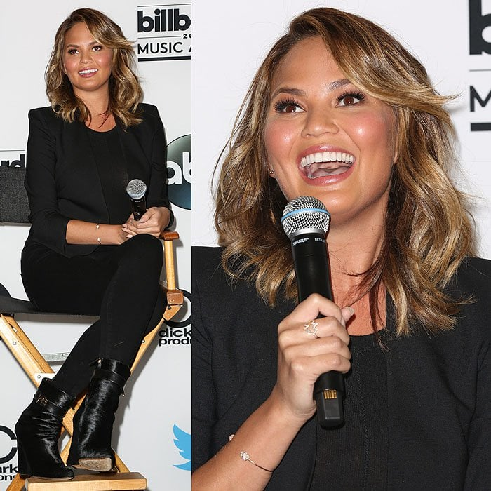 Chrissy Teigen answering questions during the 2015 Billboard Music Awards finalists press conference