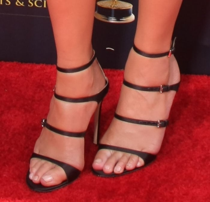 Chrissy Teigen's naked feet in Gianvito Rossi sandals