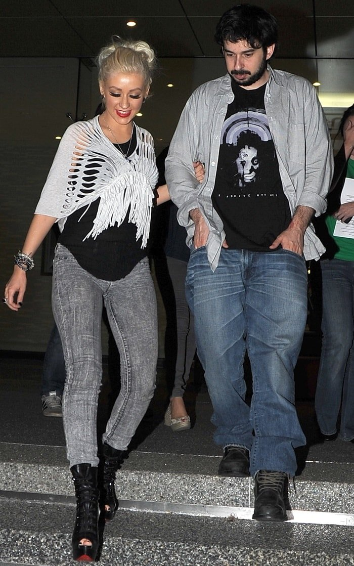 Christina Aguilera and her husband, producer Jordan Bratman, walk arm-in-arm