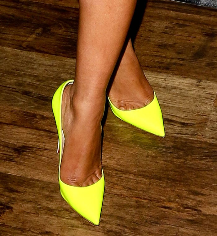 Christina Milian's sexy toe cleavage in neon yellow shoes