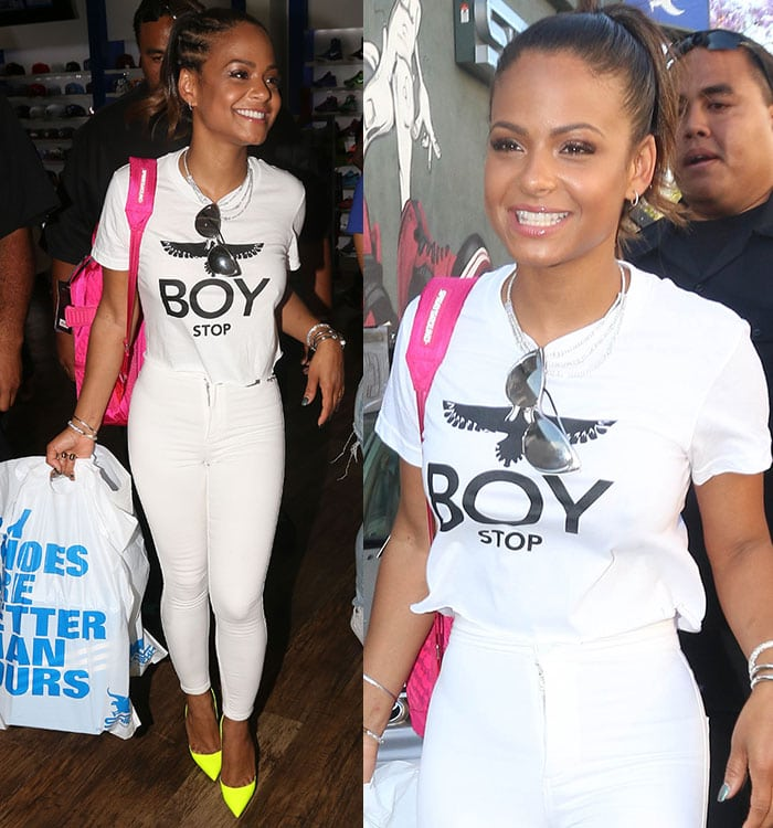 0f3d61992 Christina Milian flashing her pearly teeth while carrying her bulging  shopping bags