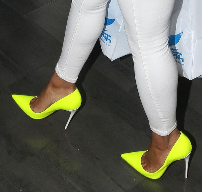 Christina-Milian-shops-in-neon-Christian-Louboutin-pumps