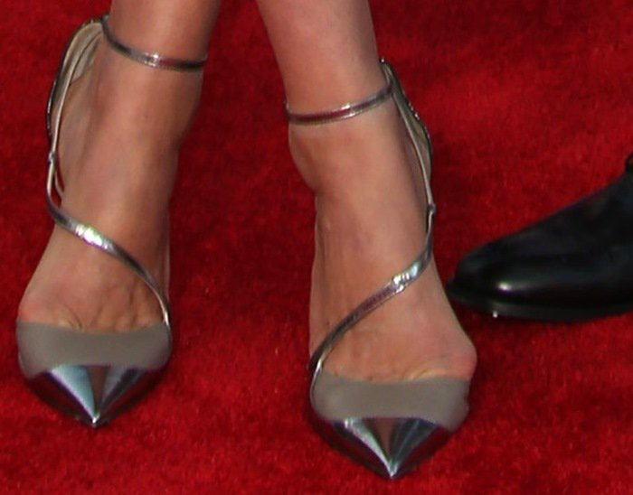 "Cobie Smulders' feet in metallic silver ""Minati"" pointy-toe pumps from Jimmy Choo"