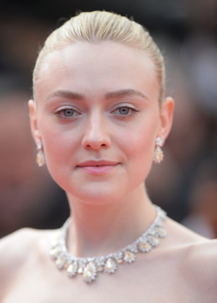 Dakota Fanning accessorized with Chopard jewelry for the Once Upon A Time In Hollywood premiere