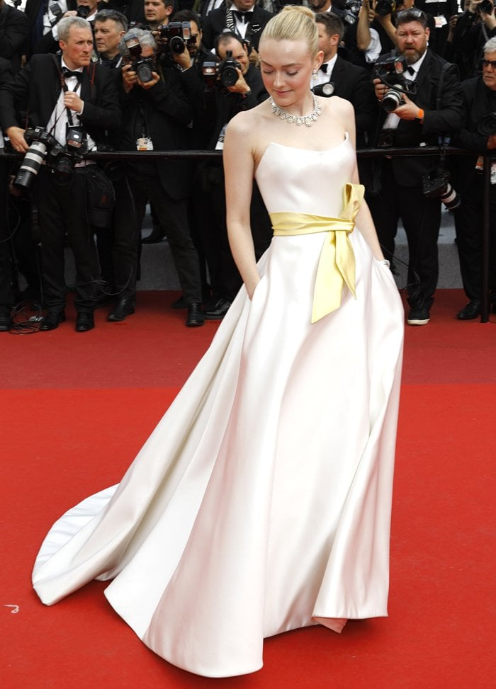 Dakota Fanning, whose estimated net worth is $16 million, in a striking pale pink Giorgio Armani Privé gown