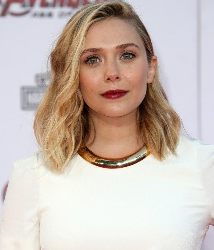 Elizabeth Olsen wearinga sleep-inducing two-tone crepe t-shirt gown from Galvan
