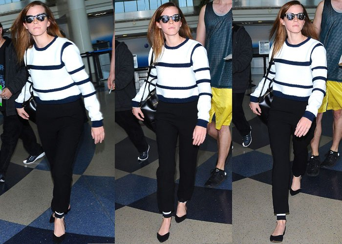 Emma Watson wore loose pants and a striped sweater