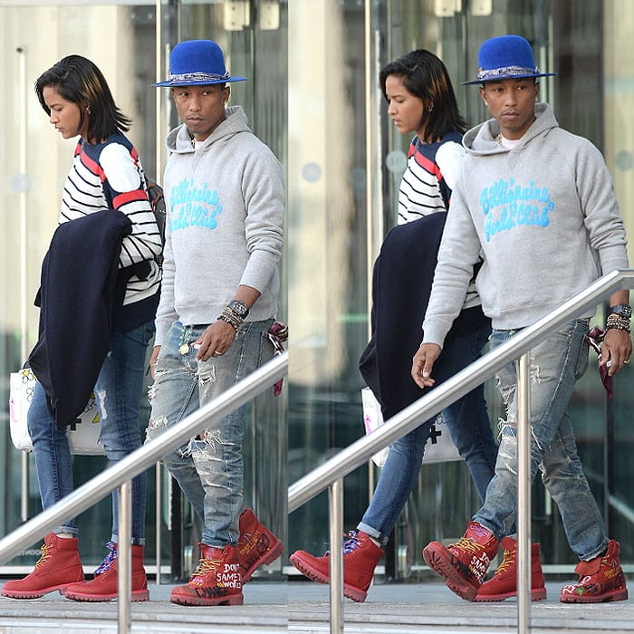 Pharrell Williams and wife Helen Lasichanh leaving their hotel in Manchester, England, on September 10, 2014