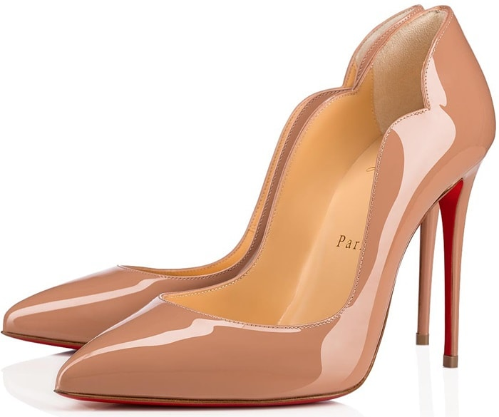 A curvy, scalloped counter and willowy stiletto heel dial up the drama on a pointy-toe pump finished with that iconic red sole