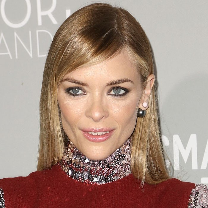 """Jaime King wearing Christian Dior's popular """"Mise En Dior"""" double-pearl earrings featuring a larger ball stud at the back of the ear lobe"""