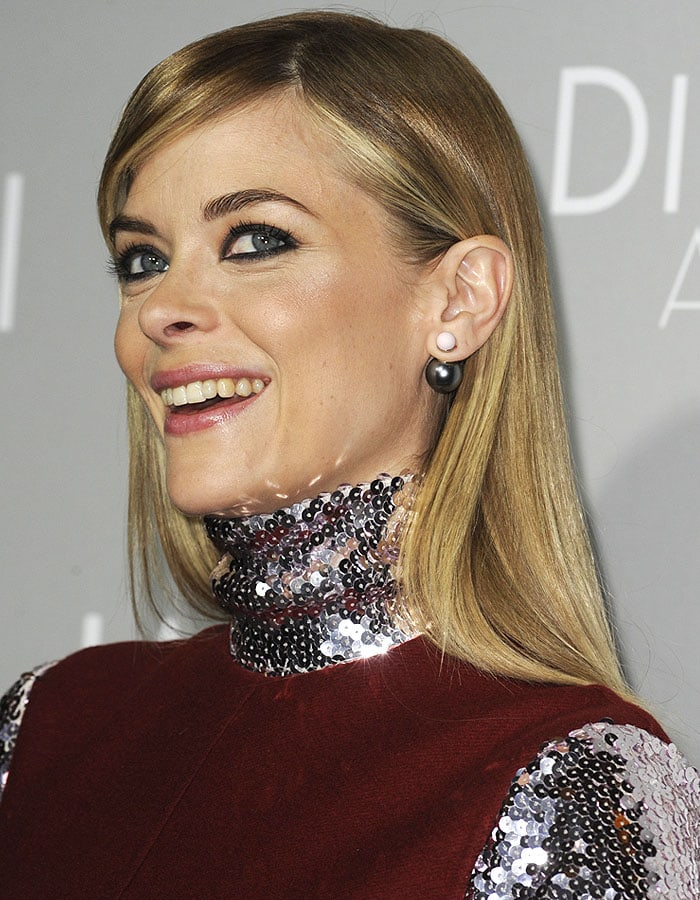 Jaime King's smiling as the sequins sparkle on the turtleneck and sleeves of her Christian Dior Pre-Fall 2015 dress