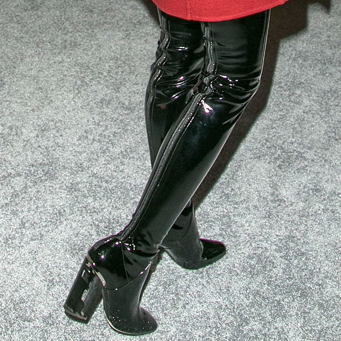 Back view of the Dior vinyl thigh-high boots showing the full-length zippers and metal heel counters