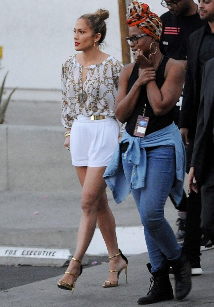 Jennifer Lopezaccessorized with large hoop earrings