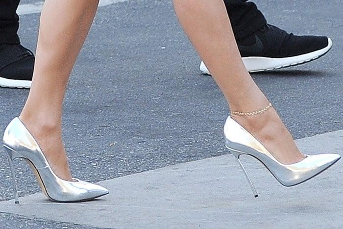 Jennifer Lopez taking a step in Casadei blade-heel pumps