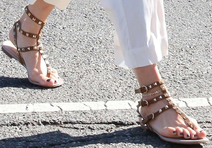 Jennifer Lopez shows off her feet in gladiator sandals