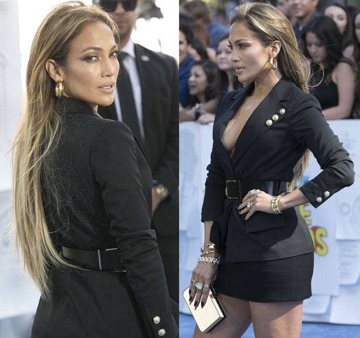Jennifer Lopez looked sexy in a tailored plunge blazer and miniskirt