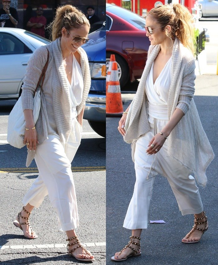 Jennifer Lopez wears a plunging white top and loose-fitting pants