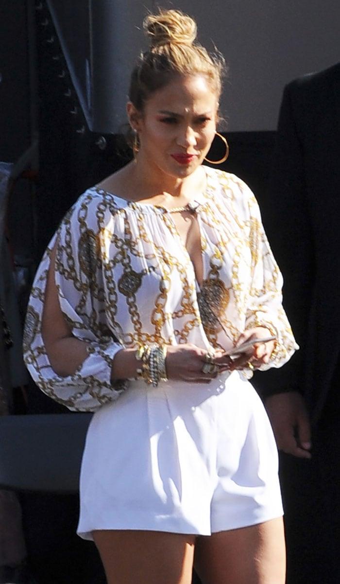 Jennifer Lopez flashing her legs in high-waisted shorts