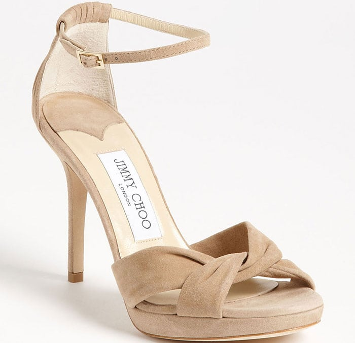 Prim pleats finish the feminine appeal of a twisted, ankle-strap sandal in lusciously soft suede.