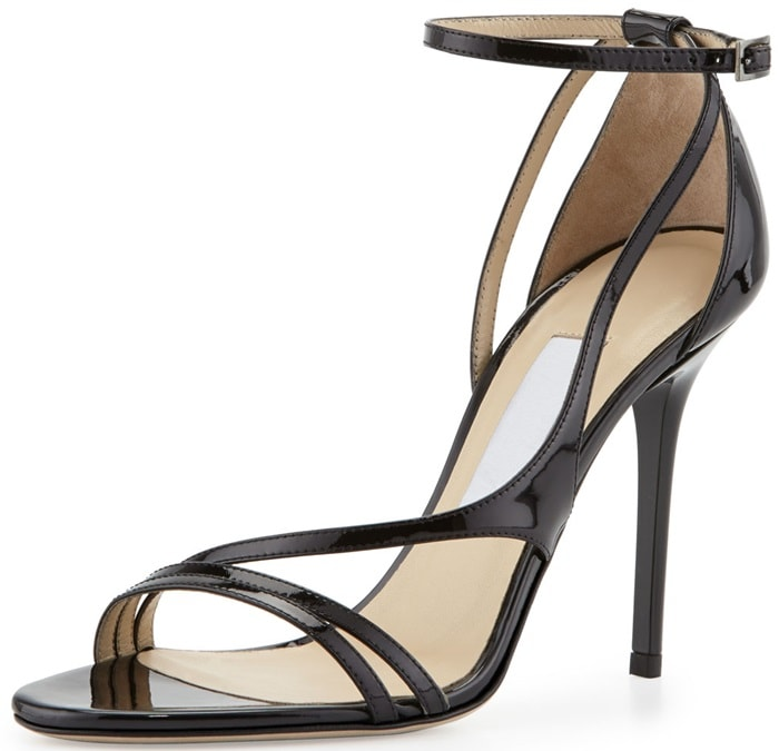 The slender straps of this Jimmy Choo sandal flatter cocktail dresses in high-gloss patent leather.