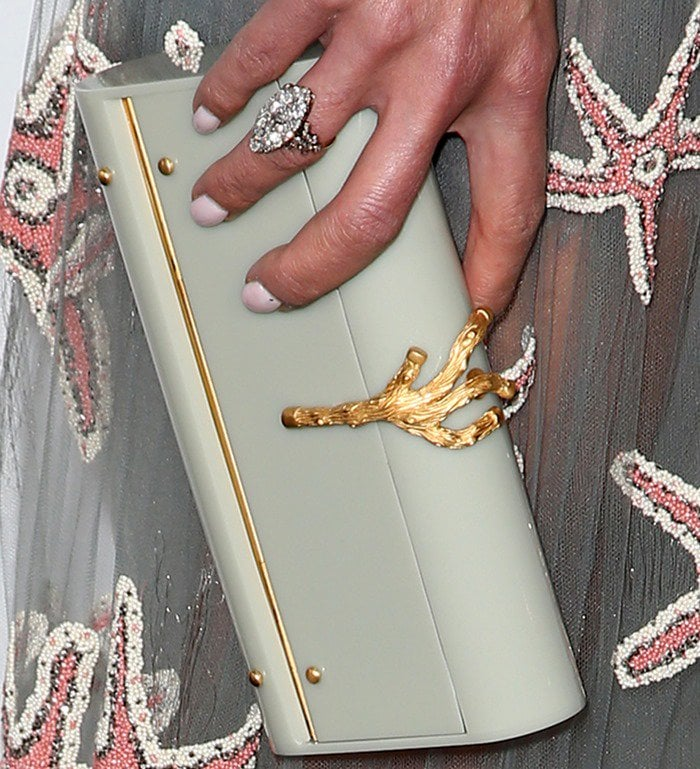 Jordana Brewster totes a Valentino clutch