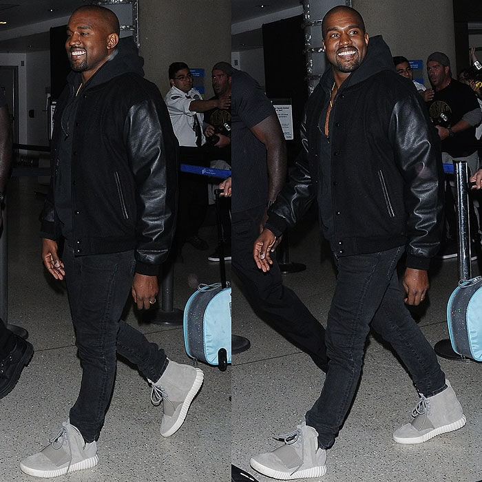 Kanye West flashing a rare smile at the paparazzi