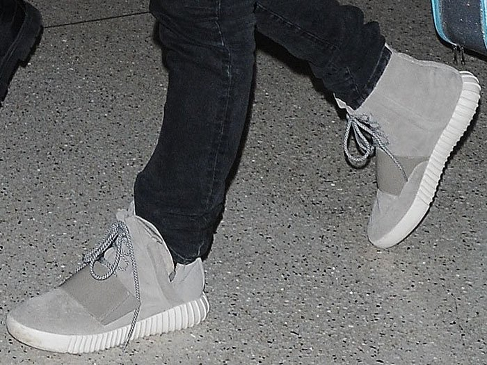 """Kanye West wearing his own design, the adidas x Kanye West """"Yeezy 750 Boost"""" sneakers"""