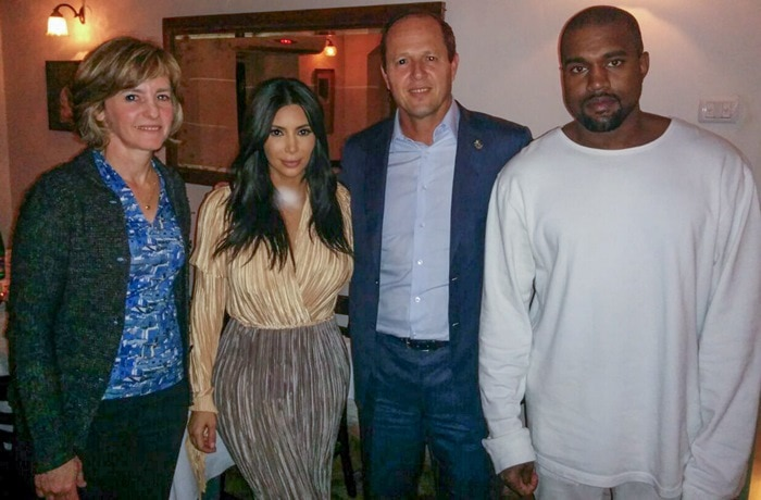 """Kim Kardashian and her rapper husband Kanye West with Mayor of Jerusalem Nir Barkat and his wife Beverly at the Mona restaurant in the Israeli capital on April 13, 2015. Barkat said """"they raised a toast to Jerusalem and he asked the couple to be ambassadors of Jerusalem and tell all that Everyone is welcome in Jerusalem""""."""