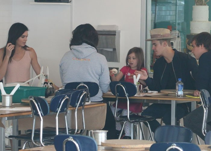 Kendall Jenneraccompanying Justin Bieber as he brought his little sister to a baking session