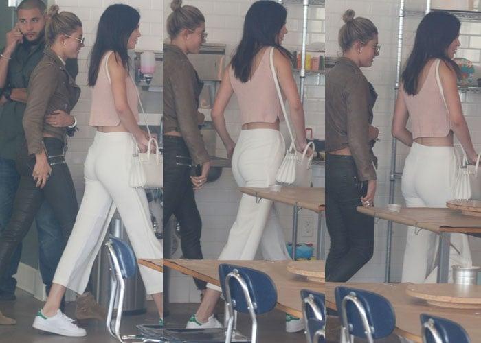 Kendall Jenner totinga gorgeous white Saint Laurent purse