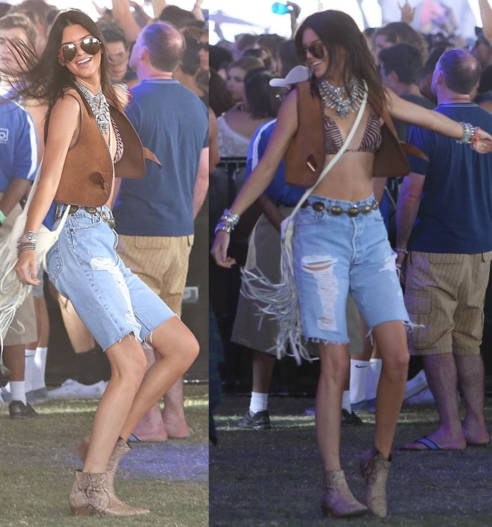 Kendall Jenner flaunted her legs in a bikini top, a brown Derek Lam 10 Crosby vest, and torn cutoff jeans
