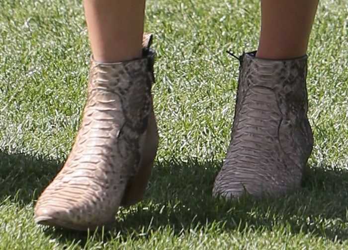 Kendall Jenner's dance boots feature tapered toes and pull tabs at the back