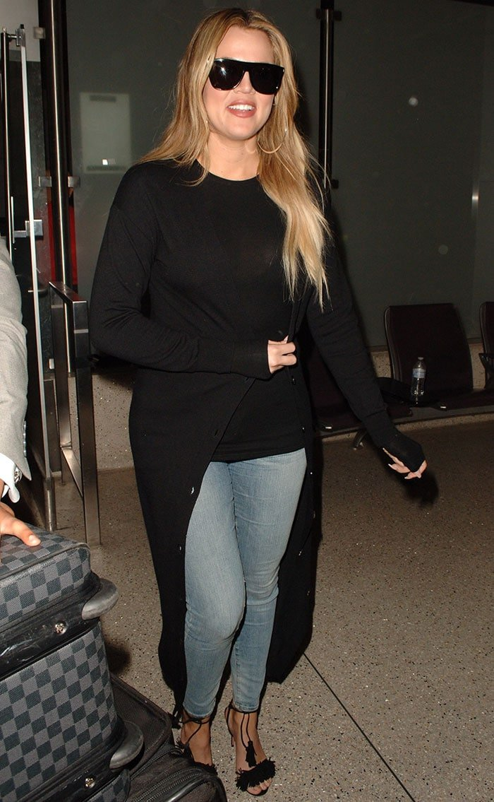 Khloe Kardashian in a clingy black top and faded jeans