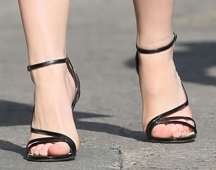 Kiernan Shipka showed off her toes in black shoes
