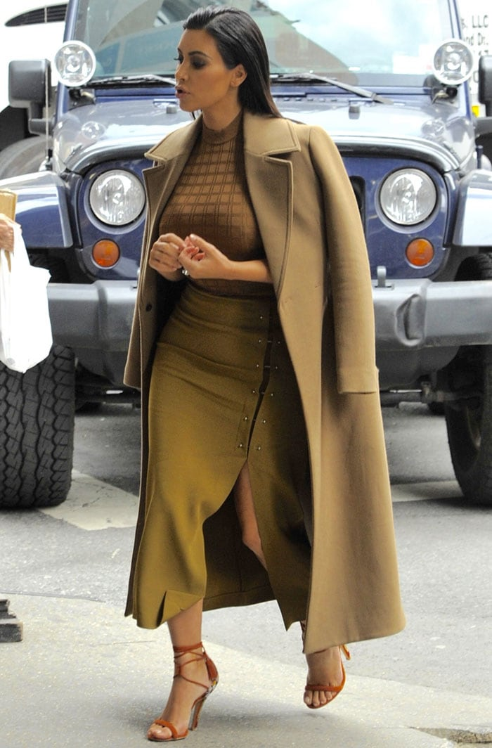 Kim Kardashian's olive green skirt with a thigh-high slit and some unusual pin details