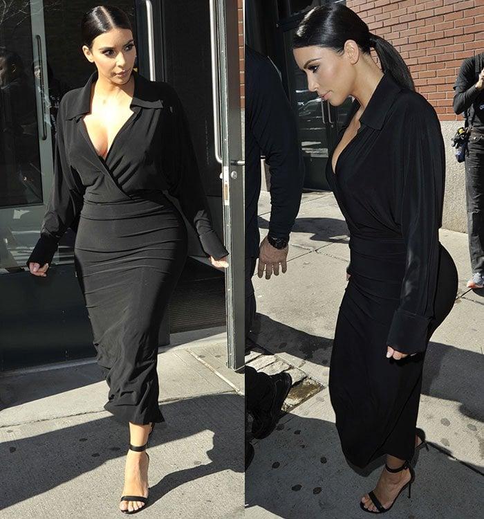 Kim-Kardashian-in-a-black-plunging-wrap-dress