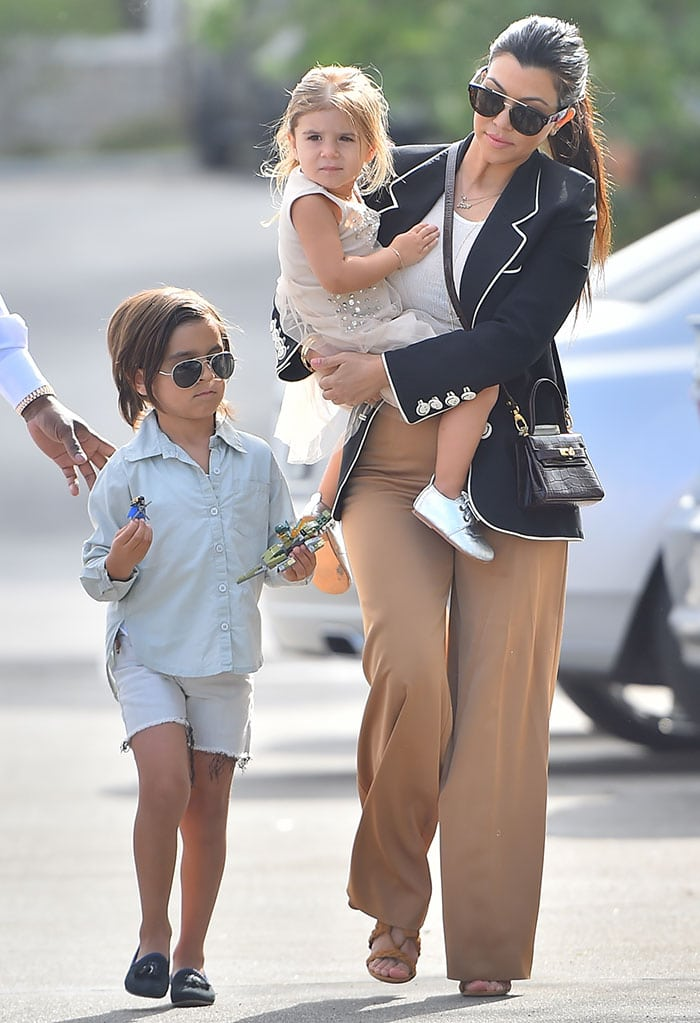 Kourtney Kardashian, Mason Disick, and Penelope Disick on their way to attend the Easter service at West Hills Church in the San Fernando Valley on March 5, 2015