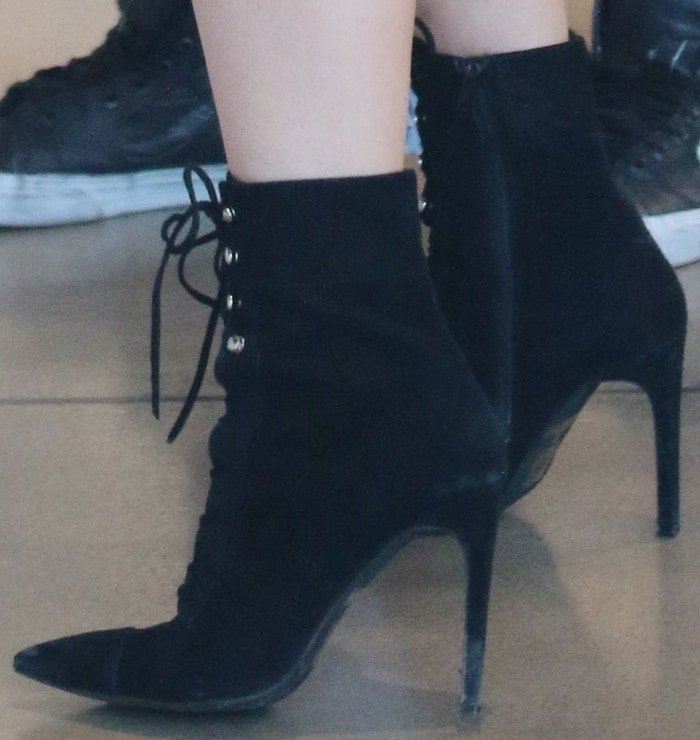 Kylie Jenner's hot legs in Elphaba boots by Jeffrey Campbell