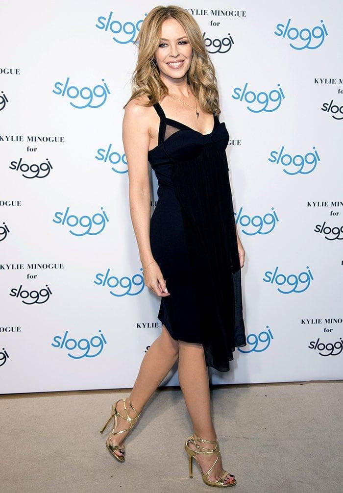 33544defaf6 Kylie Minogue Promotes Sloggi Underwear in Sports Bra and Nude Heels