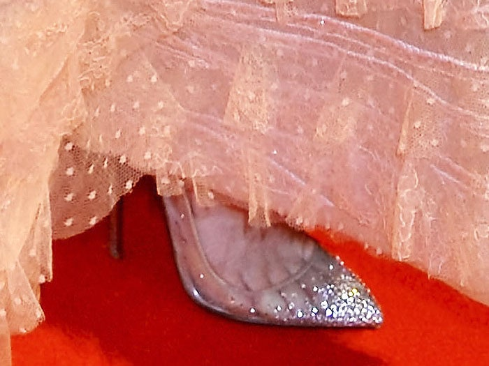 "Closeup of the Christian Louboutin ""Follies"" strass mesh pumps on Lily James' feet"